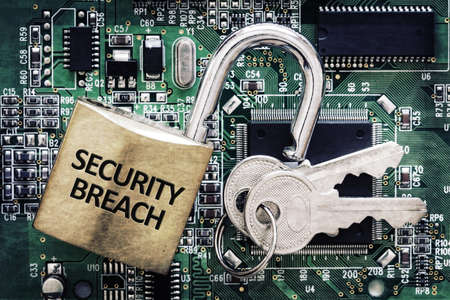 security breach: Internet computer security and network protection concept, padlock and key on circuit board