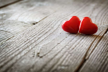 Two hearts on a wooden background concept for love, dating and romance with coyspace photo