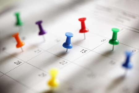 appointment: Thumbtack in calendar concept for busy, appointment and meeting reminder