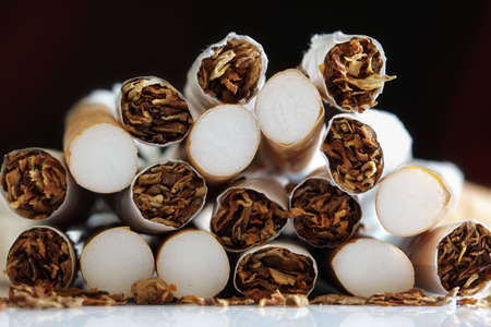 quitting: Broken cigarette ends in a heap concept for quitting smoking and healthy lifestyle