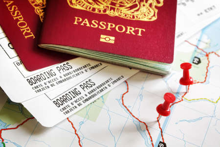 airplane ticket: Boarding pass and passport on map with thumbtack concept for travel and vacations Stock Photo