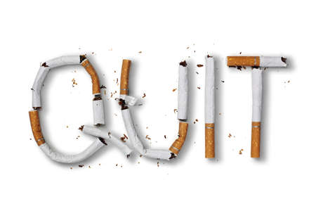 Quit smoking word written with broken cigarette concept for quitting smoking 스톡 콘텐츠
