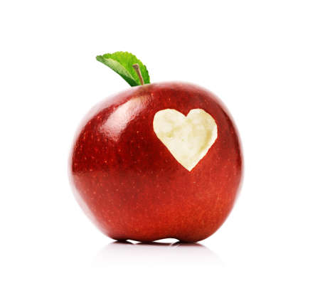forbidden love: Red delicious apple with a love heart shape bitten into the flesh Stock Photo