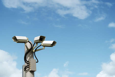 paranoia: Security cctv surveillance camera in front of blue sky with copy space