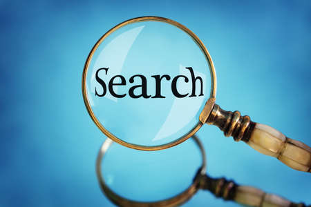 looking glass: Magnifying glass focus on the word search concept for searching the internet, examination and exploration