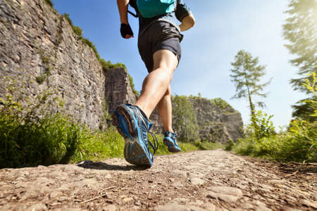 trails: Outdoor cross-country running in summer sunshine concept for exercising, fitness and healthy lifestyle