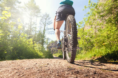 racing bike: Mountain biker in action on a forest trail concept for healthy lifestyle, excercise and extreme sports Stock Photo