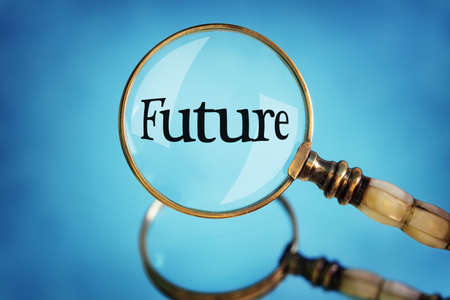 forward: Magnifying glass focus on the word future concept for planning, vision and  looking forward Stock Photo