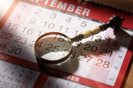 important date: Calendar planning magnifying glass resting on an important date concept fpr deadline business appointment or meeting Stock Photo