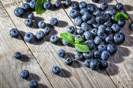 Blueberry antioxidant organic superfood on wooden table concept for healthy eating and nutrition