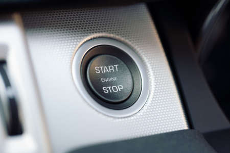 hybrid car: Engine start and stop button on electric hybrid car dashboard
