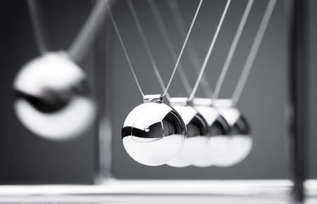 Newton's cradle physics concept for action and reaction or cause and effect 스톡 콘텐츠