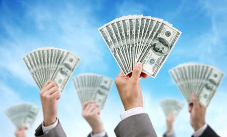 Venture capital or crowd funding finance and investment concept businessmen holding up dollar currency aloft Stock Photo
