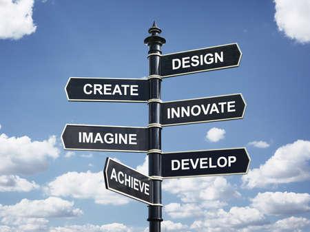 設計、作成、革新、想像する、開発および達成動機の方向標識 写真素材