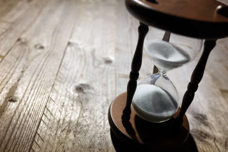 time: Hourglass time passing concept for business deadline, urgency and running out of time