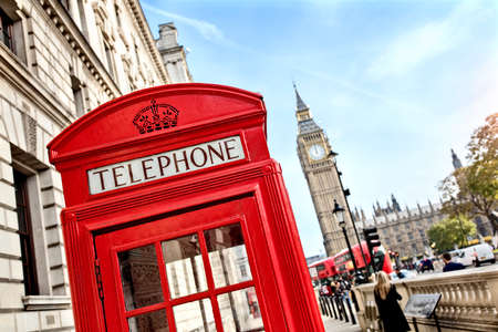 london big ben: London telephone booth in front of  big ben and the houses of parliament in England