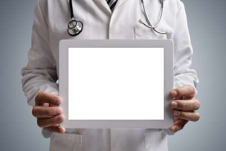 exam results: Doctor holding a blank digital tablet screen for copy medical concept