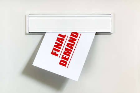 repayment: Final demand notice on letter being delivered through a letterbox concept for unpaid bill, late payment and repayment financial worry
