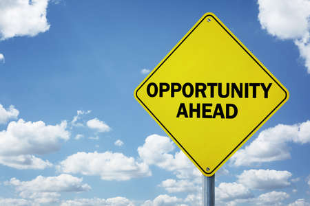Opportunity ahead road sign concept for business development, progress, choice and direction or employment issues Imagens