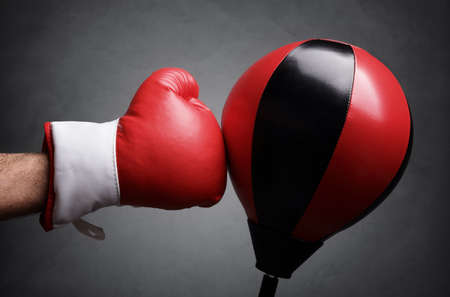 sports winner: Punching a red punch bag concept for competition, challenge, conflict or leadership in business