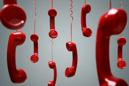 contact: Red telephone receiver hanging over gray background concept for on the phone, on hold or contact us