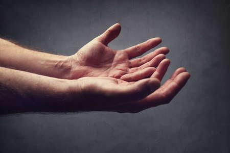 cupped hands: Hands reaching out concept for help, religion, salvation, forgiveness, assistance and love or begging