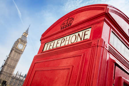 england big ben: London telephone booth in front of  big ben and the houses of parliament in England