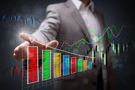 Businessman pointing to a growth chart showing business success