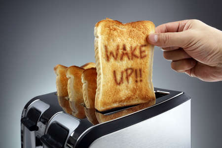 wakening: Good morning wake up toasted bread slice in a toaster, motivation to get started