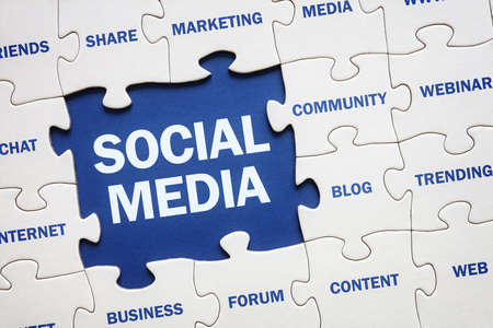 internet marketing: Social media concept jigsaw piece reading marketing, networking, community, internet etc Stock Photo