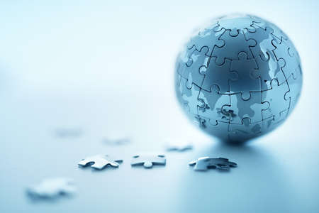 puzzle globe: Global strategy solution concept - earth jigsaw puzzle Stock Photo