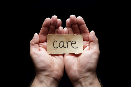 caring for: Care with the protection of cupped hands, concept for love, help, assistance, security and caring