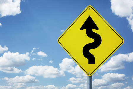 difficulties: Winding arrow road sign concept for business difficulties, problems and confusion