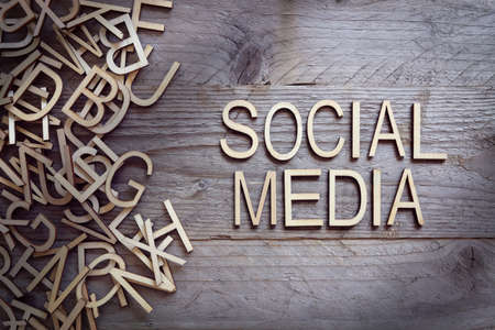 network concept: Social media and network concept wood letters on wooden background