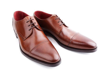 Classic brown mans handcrafted leather shoes isolated on white Archivio Fotografico