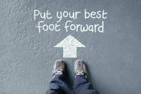 put forward: Put your best foot forward man standing with direction arrow to move forward
