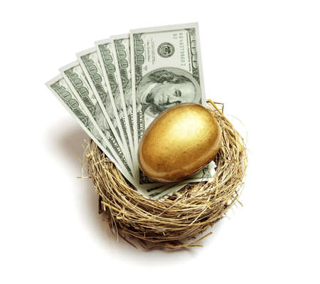 retiring: Gold nest egg and money concept for retirement savings and financial planning Stock Photo