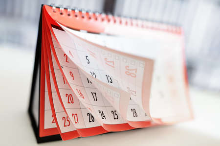 Months and dates shown on a calendar whilst turning the pages Archivio Fotografico
