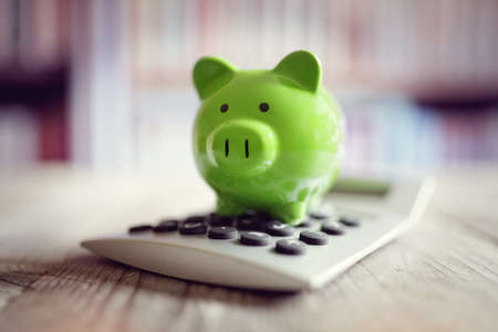 Piggy bank on calculator concept for saving, accounting, banking and business account Reklamní fotografie - 67012343