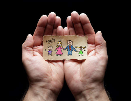 Family care with the protection of cupped hands, concept for love, help, assistance, security and caring