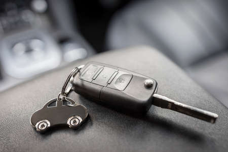 Car shape keyring and remote control key in vehicle interior