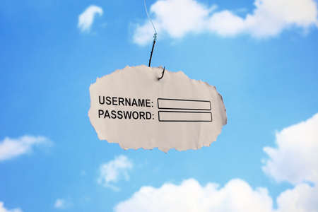 Computer username login and password on paper attached to a hook concept for phishing or internet security Stock Photo