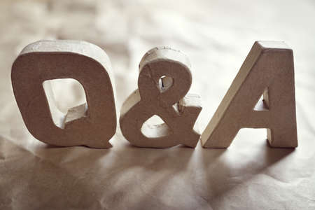 Questions and answers Q & A title made from cardboard letters Lizenzfreie Bilder
