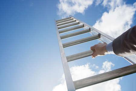 Businessman climbing the corporate ladder of success