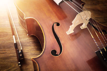 Cello on wood background with copy space for music concept Stock Photo