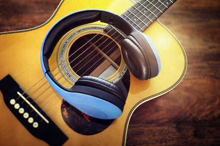 Guitar and headphones concept for listening to music or recording studio equipment