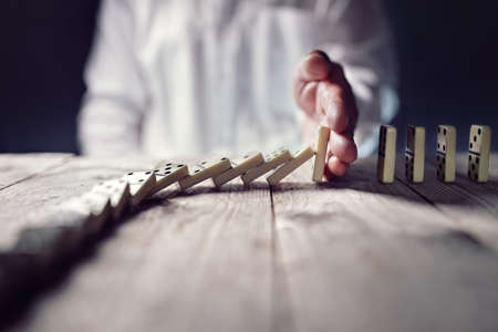 Stopping the domino effect concept for business solution, strategy and successful intervention Stok Fotoğraf