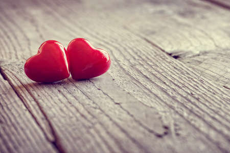 Two valentines day hearts on a wooden background concept for love, dating and romance with copy space Standard-Bild