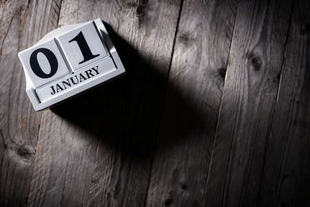 January 1st calendar on wood background new year concept