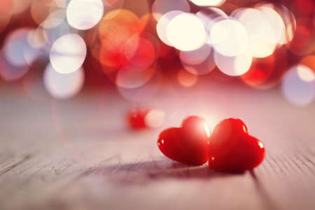 Two valentines day hearts on a wooden background concept for love, dating and romance with copy space Stock Photo